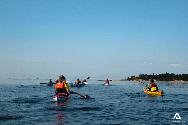 People Kayaking In The Ocean