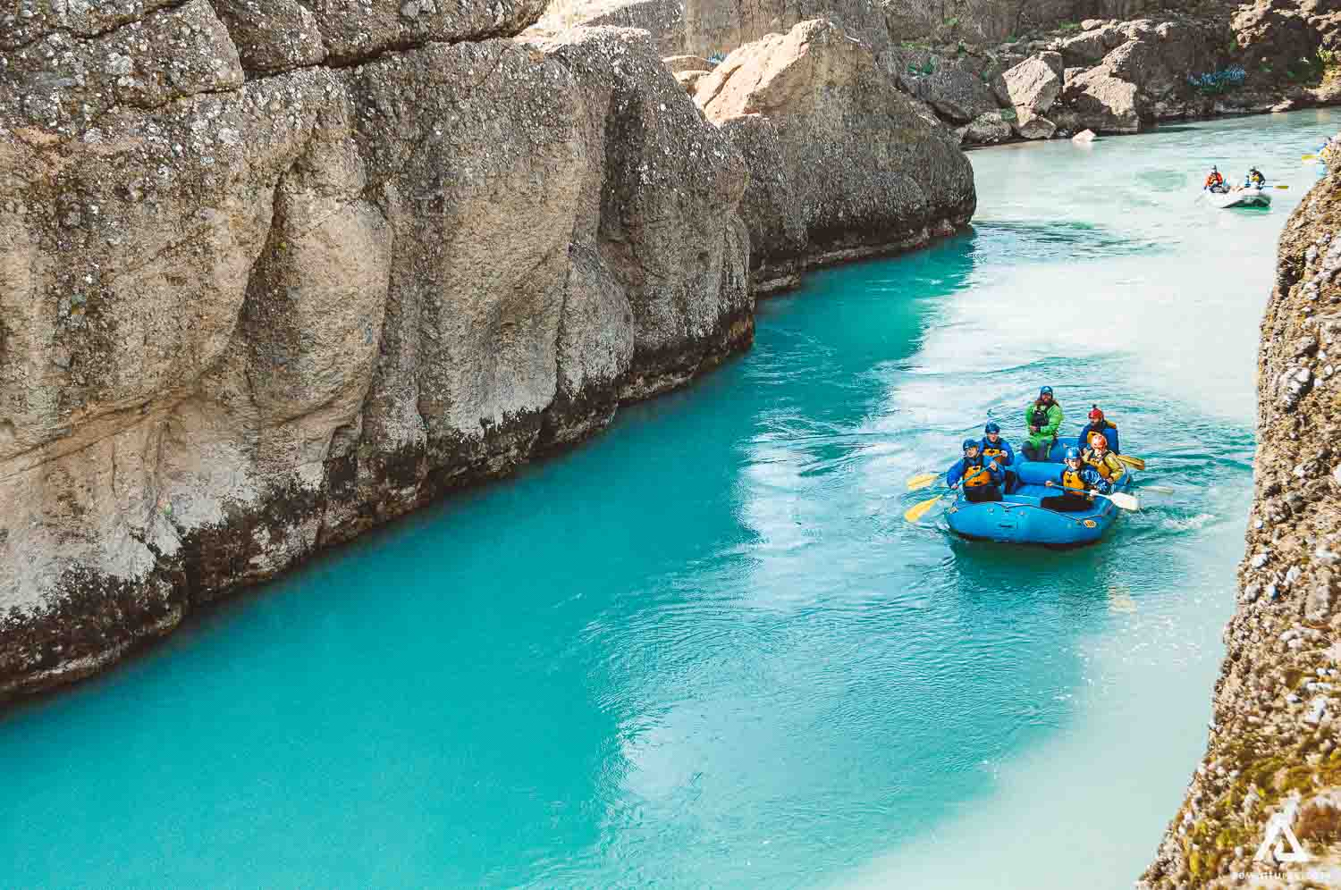 People Are Rafting On The River Between The Rocks