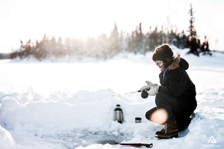 ice fishing in a lake