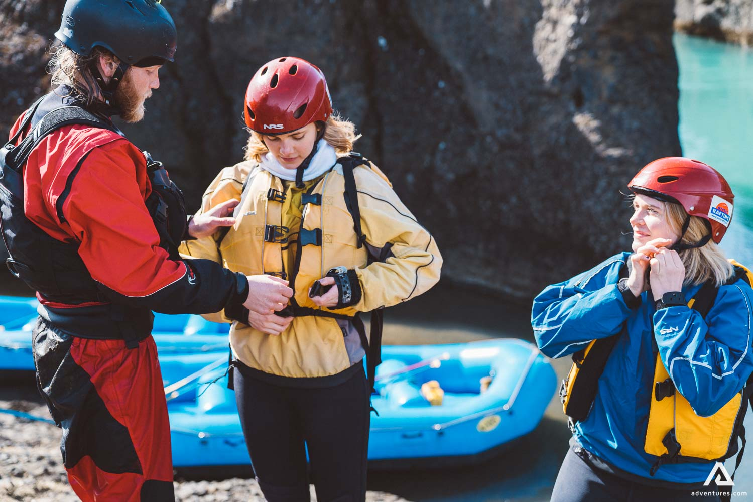 Three People Are Preparing For Rafting
