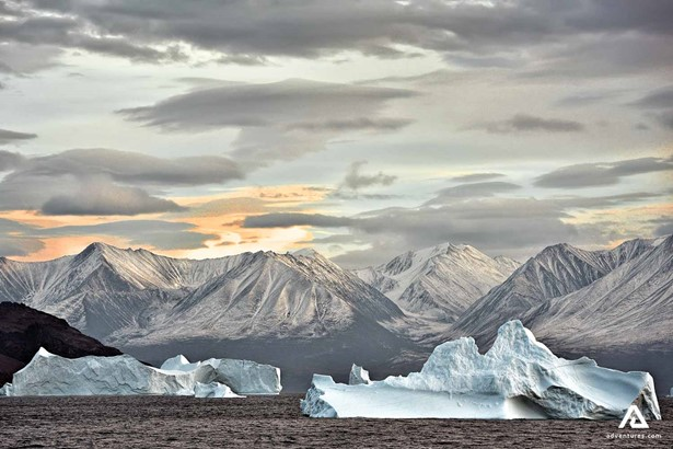 The icebergs of Greenland near mountains