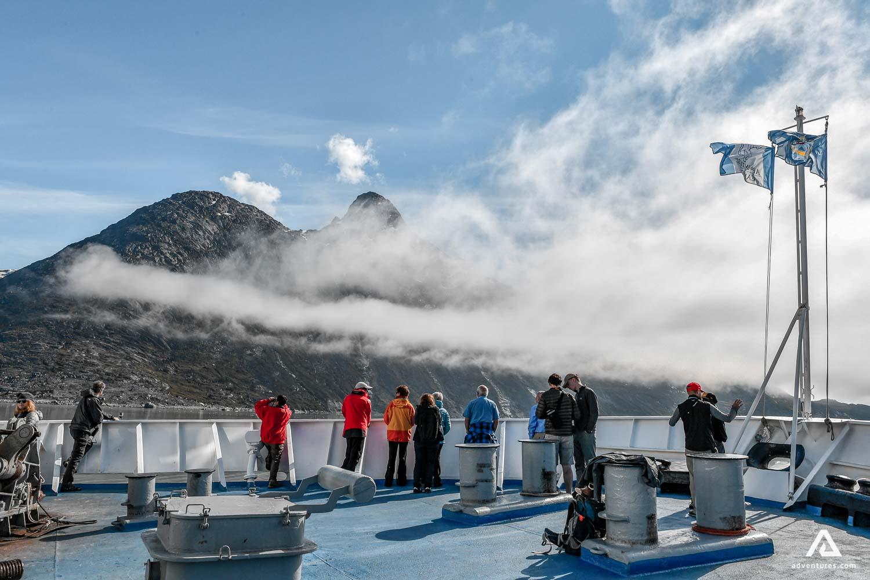Tourist on a cruise exploring Arctic nature