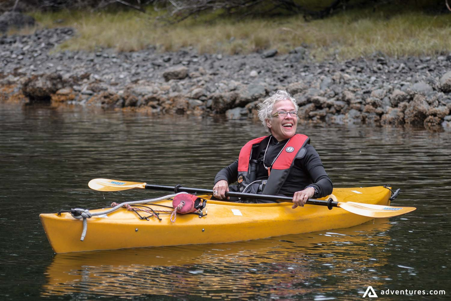 Happy woman on a kayaking tour