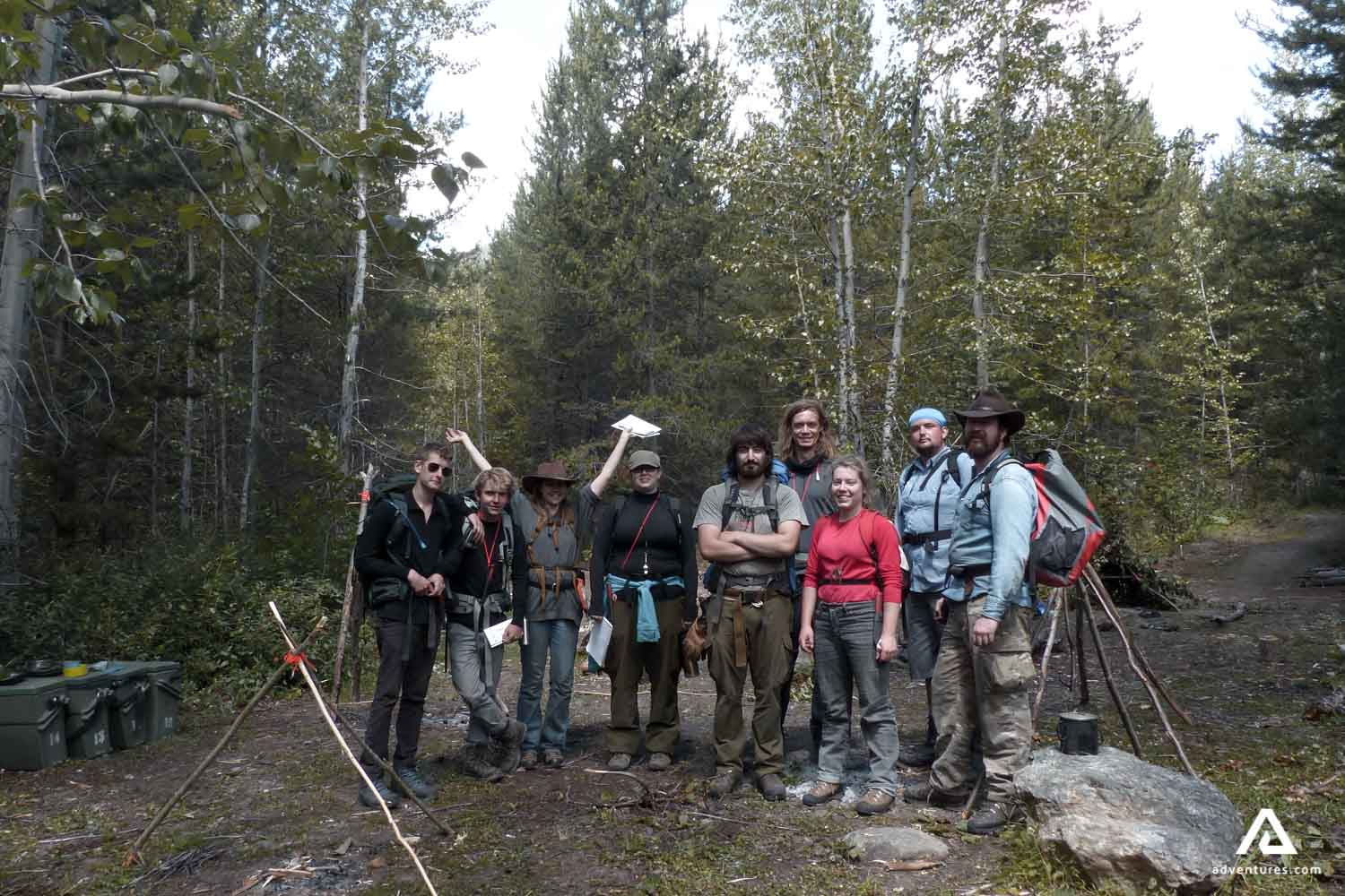 A group of tourists on wilderness survival training