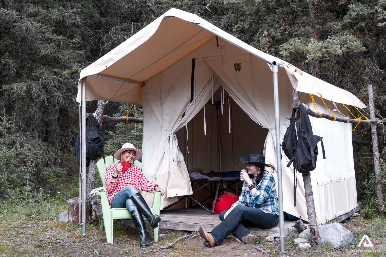 Girls resting in a campsite